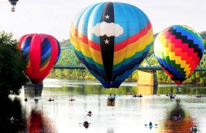 "During the 2013 Great Falls Balloon Festival, hot air balloons gently touched the surface of the Androscoggin River in a ""splash-and-dash"" exhibition."